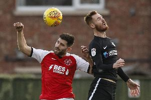 Ched Evans challenges Tom Naylor during Pompey's 5-2 victory at Fleetwood in December 2018. Picture: Daniel Chesterton/phcimages.com/PinPep