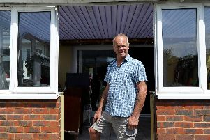 Phil Neville of Hayling Island, pictured in the space in the conservatory where his faulty B&Q French doors were meant to go.       Picture: Chris Moorhouse (260619-17)