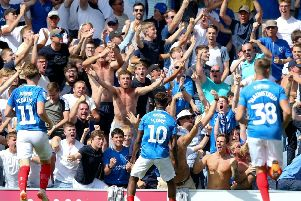 Fans celebrate at Fratton Park. Picture: Andrew Fosker/PinPep