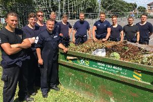 The team from HMS Diamond pictured by the skip full of