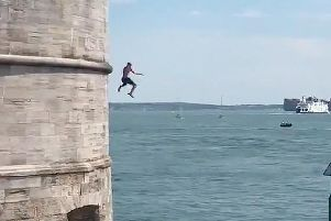 People tombstoning off the Round Tower, Old Portsmouth.'Picture: Proud of Portsmouth
