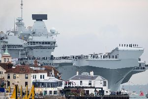 HMS Queen Elizabeth arriving at Portsmouth Harbour earlier this year. Picture: Steve Parsons/PA Wire