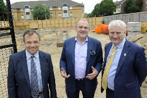 Lib Dem leader candidate Ed Davey chats to Councillor Darren Sanders (left), and Councillor Gerald Vernon-Jackson during a visit to a new city build in Somerstown.'Picture Ian Hargreaves  (100719-02)