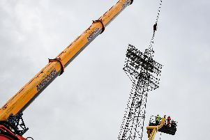 The old lights being removed. Picture by Colin Farmery