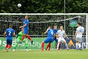 Ross McCrorie heads the ball clear against UCD, his only Pompey outing so far. Picture: Arnold Byrne