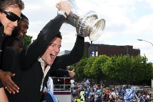 David Nugent hoists the FA Cup aloft during the open-top bus parade in 2008. Picture: Joe Pepler/ Portsmouth FC