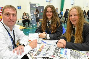 The News' education reporter, Neil Fatkin, with Luisa Marthinsen, 15, and Molly Cooper, also 15. Picture: Malcolm Wells (190717-4077)