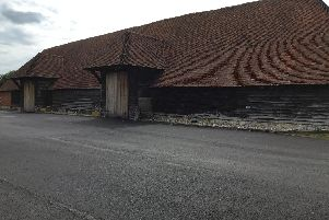 The 15th century barn surrounded by the new tarmac.