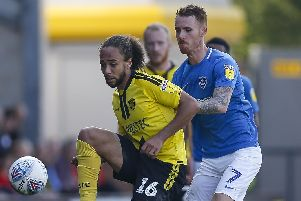 Marcus Harness holds off Tom Naylor during Pompey's win over Burton in April. Picture: Daniel Chesterton/phcimages.com
