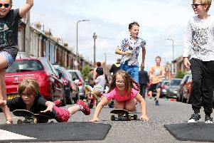 The Billson and Terry children play in the road as Francis Avenue, Portsmouth, becomes a play street. Picture: Chris Moorhouse. (210719-59)