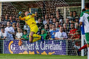 Alex Bass, seen here pulling off a save against Bognor last week, will feature for a young Pompey XI against Aldershot tomorrow night. Picture: Tommy McMillan