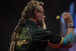 Simon Whitlock with his elbow strapped up at Winter Gardens, Blackpool. Picture: Lawrence Lustig/PDC
