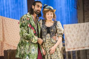 Scott Karim as Ali Hakim and Bronte Barbe as Ado Annie in Oklahoma! at  the Chichester Festival Theatre, summer 2019. Picture by Johan Persson