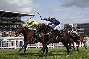 Hey Gaman, right, wins The Denford Stakes at Newbury earlier in his career. Picture: Alan Crowhurst/Getty Images
