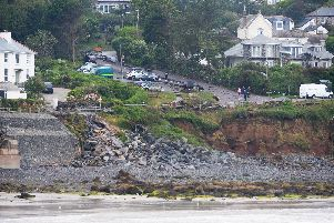 Rocks and debris which have fallen away from the sea wall in Coverack, Cornwall, after intense rain caused flash flooding in the coastal village.