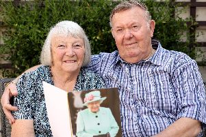 Sheila and Morris (known to as Morrie) Joseph have just celebrated their diamond wedding anniversary. Pictured at home in Southsea, with their card from the Queen. Picture: Chris Moorhouse.