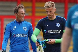 Alex Bass with Pompey goalkeeping coach John Keeley. Picture: Joe Pepler