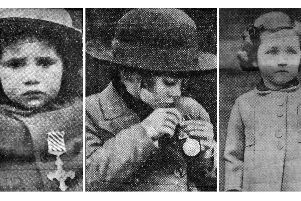 Three little girls who attended Buckingham Palace to receive their fathers medals posthumously from the King.