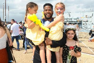 Leading Hand Herman O'Brien with his children (l-r) Eloise, four, Amber, four, and Alyssa, 10, of Gosport.''Picture: Sarah Standing (090819-2882)