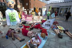 A die-in as part of a previous Extinction Rebellion demonstration in Hailsham, East Sussex. Picture: Peter Cripps