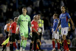 Craig MacGillivray and Christian Burgess are stunned at the final whistle following Pompey's 3-3 draw with Coventry. Picture: Robin Jones