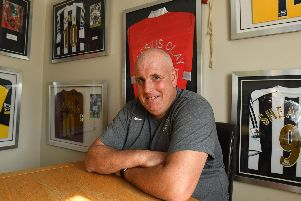 Kev McCormack, celebrating 20 years as Pompey kitman, relaxes at home with memorabilia accrued over the years. Picture: Malcolm Wells (190821-3830)
