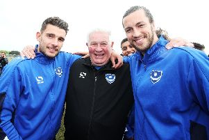 Barry Harry celebrates with Gareth Evans (left) and Christian Burgess (right) at Pompey's League Two title-winning celebrations on Southsea Common in May 2017. Picture: Joe Pepler