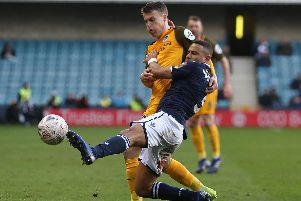 James Meredith battles Solly March for the ball during Millwall's FA Cup quarter-final against Brighton last season. Picture: DANIEL LEAL-OLIVAS/AFP/Getty Images)