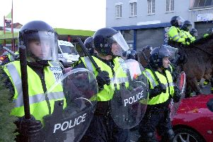 Police confront football hooligans outside Fratton Park following the match against Southampton in 2004. Picture: Malcolm Wells (041492-131)