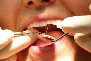 A dentist at work. Picture: PA.