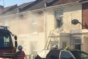Smoke billows from a house in Jervis Road, Stamshaw, as firefighters battle a suspected electrical blaze. Crews were called to the property at about 4pm and had to smash a first-floor window to gain access. Picture: Jordan Smith