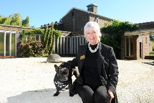Celebrant Philippa Hawkins from Fareham, has a very special helper at funerals - her French bulldog, Maisie (4). Maisie is a funeral therapy dog, who comforts people during services. Picture: Sarah Standing (170919-6390)