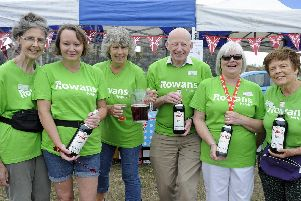 The Rowans Hospice summer fete has been held at Castle Field in Southsea.'(l to r)''Volunteers, Rose Wycherley, Nicky Orton, Helen Dawes, Ian Young, Wendy Greenish, Maureen Tett.'Picture: Ian Hargreaves  (030819-1)