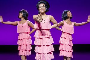 Karis Anderson, centre, as Diana Ross in Motown The Musical. Photo by Tristram Kenton.