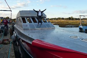 Team Britannias round the world superboat Excalibur has hit the water for the first time at a boatyard at Hayling Island. Pictured is Alan Priddy on the boat.''Picture: Team Britannia