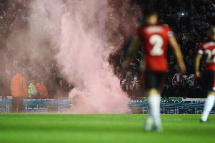 A flare at Fratton Park when Pompey played Southampton in the third round of the Carabao Cup on September 24. Picture: Joe Pepler