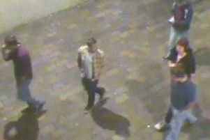 CCTV image of a group of people want to speak to after a 20-year-old man was assaulted in Guildhall Square near the Civic Offices on Thursday October 4 at 12.30am. Picture: Hampshire police
