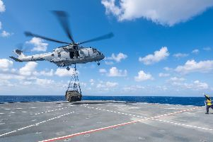 A Merlin laden with supplies lands on the deck of HMS Queen Elizabeth in America. Photo: Royal Navy/MoD