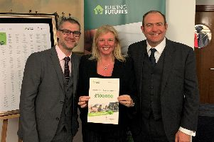 Portsmouth Down Syndrome Association founder Rachael Ross MBE, centre, with representatives from Persimmon Homes after the charity won 100,000 in the developer's Building Futures campaign.