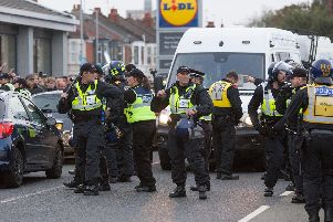 Southampton fans being escorted by police at Goldsmith Avenue, Portsmouth, as they played Pompey last month. Picture: Habibur Rahman