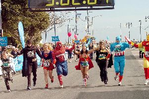 Super-Heroes competitors race to the finishing line in 2005. Picture: Michael Scaddan (054699-0799)