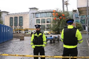Police outside the Arndale Centre in Manchester where at least four people have been treated after a stabbing incident. Picture: Peter Byrne/PA Wire