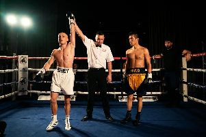 Connor Edney's arm is raised after victory on his professional debut at South Parade Pier