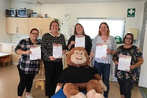 Staff from Marvels and Meltdowns in Gosport have become 'Ask Me' ambassadors for Stop Domestic Abuse. Picture: Marvels and Meltdowns