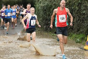 James Baker (7), left, with Julian Manning (100) during the Denmead 10k race