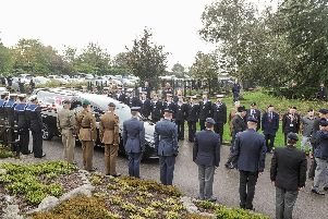 Veterans and service men and women watch as the hearse carrying Reg Tegg enters Portchester Crematorium.''Picture: Habibur Rahman