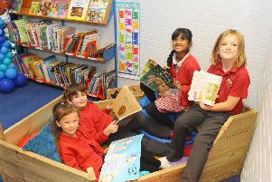 (l-r) Erin McConville, 6, Graham Jenkins, 6, Harshi Brendra, 6, and Matilda Tendler, 6, enjoy reading in the library boat.''Picture: Sarah Standing