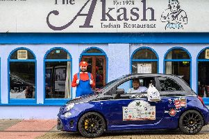 Faz Ahmed and Richard Stringer, dressed as Super Mario, ahead of Richard's Italian Job drive. Picture: The Akash