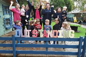 Children and staff celebrate Good Manors Day Nursery's outstanding Ofsted.