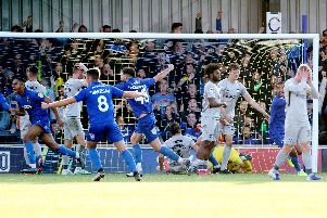 Pompey's players are in agony after Terell Thomas nets a last-gasp winner for AFC Wimbledon. Picture: Joe Pepler